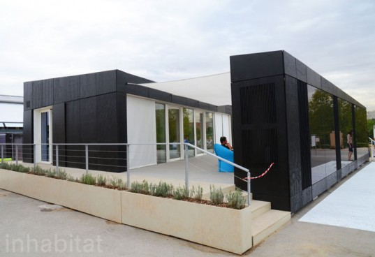 House Wrapped in Photovoltaic Panels